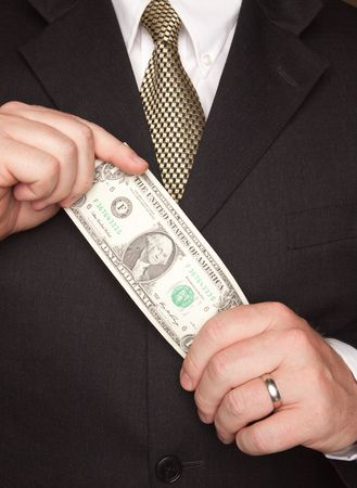 Businessman with Coat and Tie Holding Dollar Bill. photo