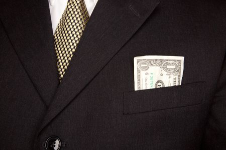 stated: United Stated Dollar Bill in Businessmans Coat Pocket.