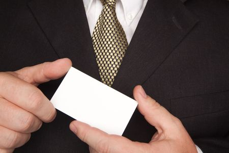 Businessman with Coat and Tie Holding Blank Business Card. Stock Photo - 4675164