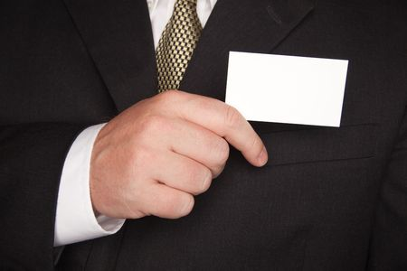 Businessman with Coat and Tie Holding Blank Business Card. Stock Photo - 4675157