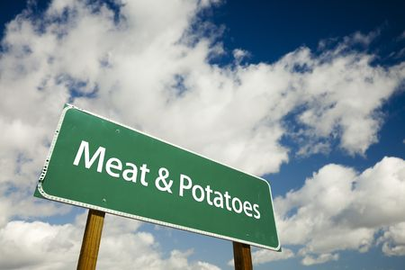 gist: Meat and Potatoes Road Sign with dramatic clouds and sky. Stock Photo