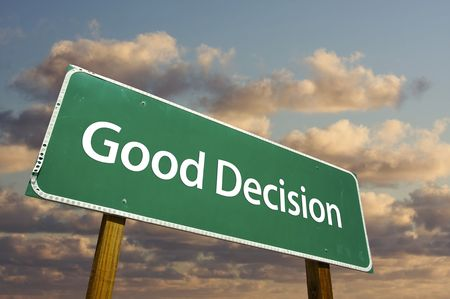 good: Good Decision Green Road Sign with dramatic clouds and sky.  Stock Photo