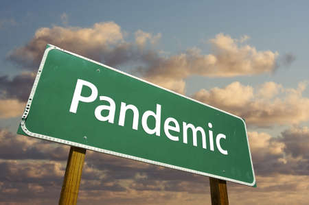 pandemic: Pandemic Green Road Sign with dramatic clouds and sky.