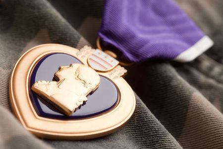 valor: Purple Heart War Medal on Camouflage Material