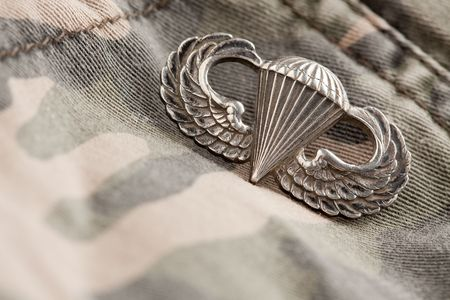 valor: Paratrooper War Medal on a Camouflage Material. Stock Photo