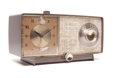 facing right: Vintage Clock Radio Isolated Facing Right on a White Background.