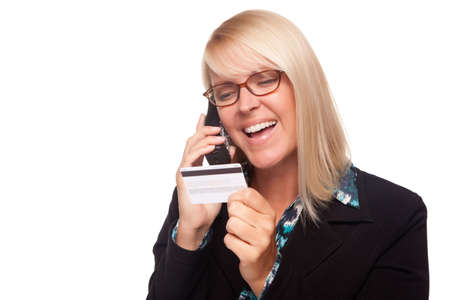 Beautiful Blonde Woman with Phone and Credit Card Isolated on a White Background. photo
