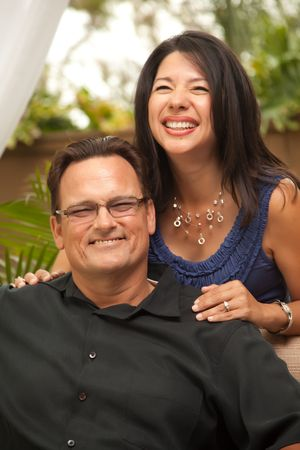 Happy Attractive Hispanic and Caucasian Couple Portrait. Stock Photo - 5016500