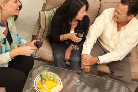 Three Friends Enjoying Wine on an Outdoor Patio. photo