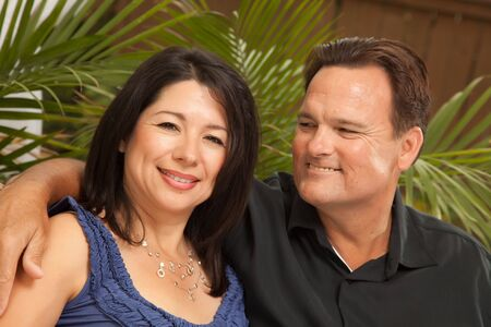 Happy Attractive Hispanic and Caucasian Couple Portrait. photo