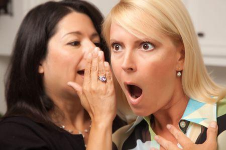Two Friends Whispering Secrets in the Ear. Stock Photo - 5022028