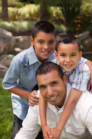 mexicans: Father and Sons Portrait in the Park.