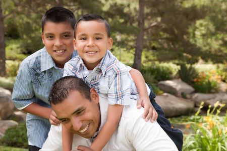 Father and Sons Portrait in the Park. photo