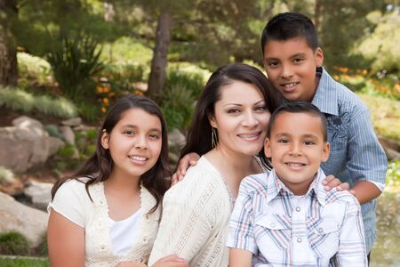 latinos: Happy Hispanic Mother and Children in the Park.