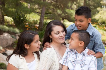 Happy Hispanic Mother and Children in the Park. photo