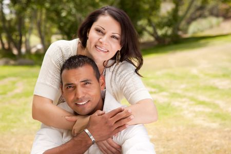 look latino: Affectionate Happy Hispanic Couple in the Park.