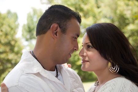 Affectionate Happy Hispanic Couple in the Park. photo