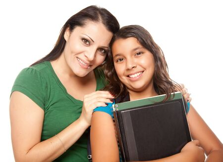 Hispanic Mother and Daughter Ready for School Isolated on a White Background. photo