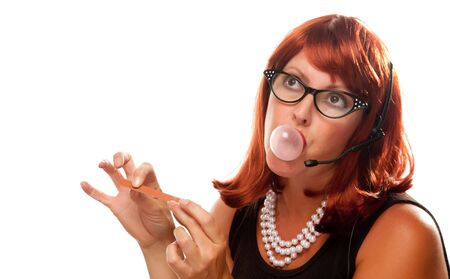 Red Haired Retro Receptionist Blowing a Bubble Isolated on a White Background. photo