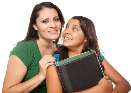 Proud Hispanic Mother and Daughter Ready for School Isolated on a White Background. photo