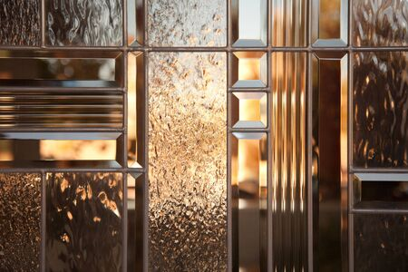 Beautiful Bevelled Glass Window with Warm Reflections. photo