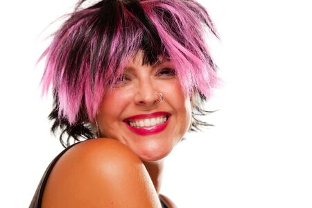 punk hair: Pink And Black Haired Girl with Nose Ring Smiling Isolated on a White Background. Stock Photo