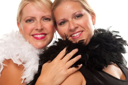 hair feathers: Portrait of Two Blonde Haired Smiling Girls with Feather Boas Isolated on a White Background.