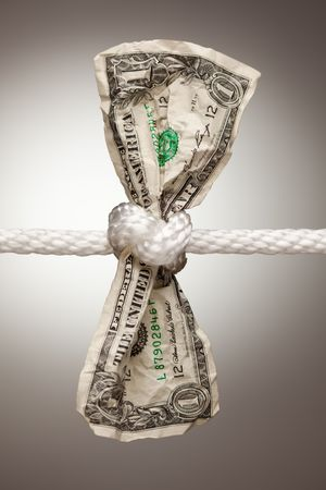 hang up: Wrinkled American Dollar Tied Up in Rope.
