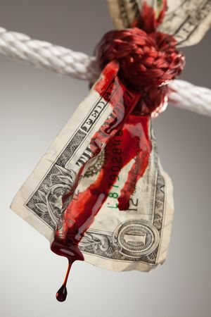 Wrinkled American Dollar Tied Up and Bleeding in Rope. photo