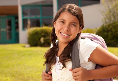 latin ethnicity: Cute Hispanic Teen Girl Student with Backpack Ready for School.