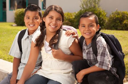 latino man: Cute Brothers and Sister Wearing Backpacks Ready for School.