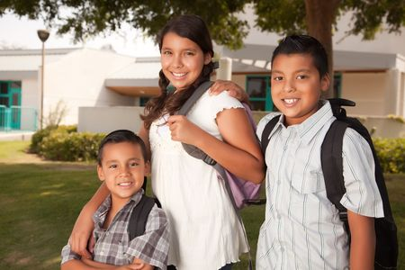 Cute Brothers and Sister Wearing Backpacks Ready for School. photo