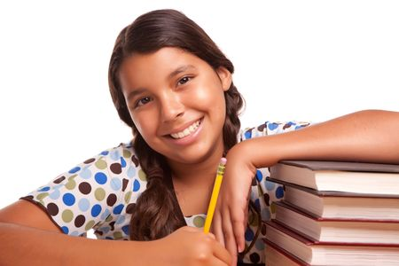 Pretty Smiling Hispanic Girl Studying Isolated on a White Background. photo