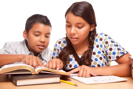 Hispanic Brother and Sister Having Fun Studying Together Isolated on a White Background. photo
