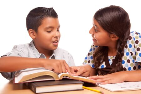 Hispanic Brother and Sister Having Fun Studying Together Isolated on a White Background. Stock Photo - 5252793