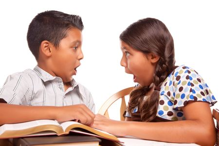 Hispanic Brother and Sister Having Fun Studying Together Isolated on a White Background. Stock Photo - 5252779