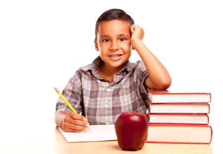 Adorable Hispanic Boy with Books, Apple, Pencil and Paper Isolated on a White Background. photo