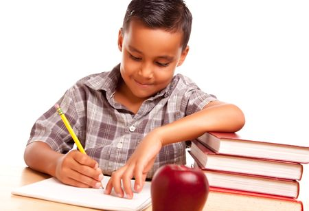 Adorable Hispanic Boy with Books, Apple, Pencil and Paper Isolated on a White Background. Stock Photo - 5252765