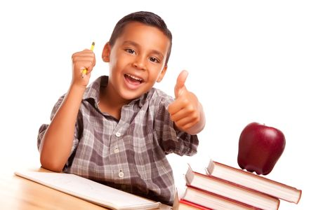 elementary students: Adorable Hispanic Boy with Books, Apple, Pencil and Paper Isolated on a White Background.