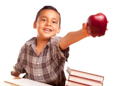 Adorable Hispanic Boy with Books, Apple, Pencil and Paper Isolated on a White Background. Stock Photo - 5252829