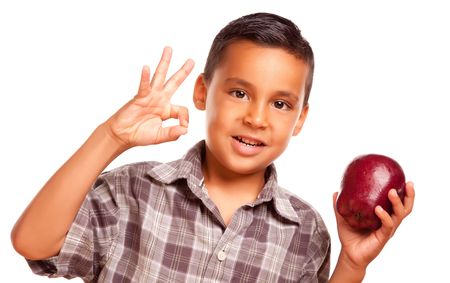 Adorable Hispanic Boy with Apple and Okay Hand Sign Isolated on a White Background. Reklamní fotografie
