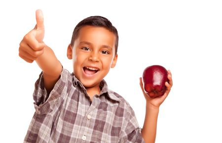 Adorable Hispanic Boy with Apple and Thumbs Up Hand Sign Isolated on a White Background. photo