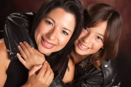 Attractive Hispanic Mother & Daughter Studio Portrait.