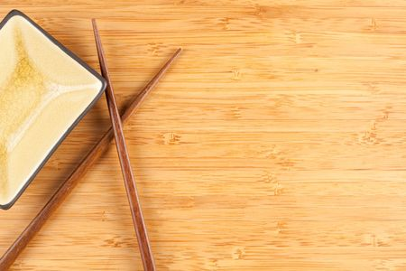 Bamboo Textured Surface Background with Chop Sticks and Bowl and Plenty of Room For Text. photo