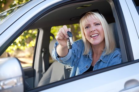 Attractive Happy Woman In New Car with Keys. photo