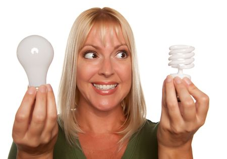 Woman Holds Energy Saving and Regular Light Bulbs Isolated on a White Background. photo