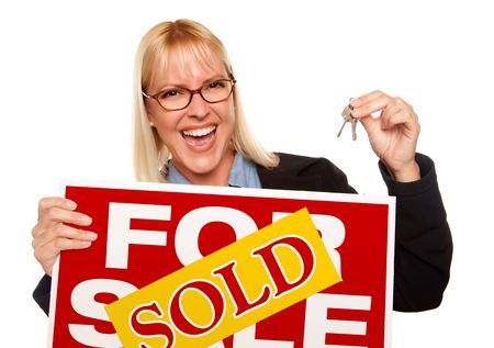 Attractive Blonde Holding Keys & Sold For Sale Sign Isolated on a White Background. photo