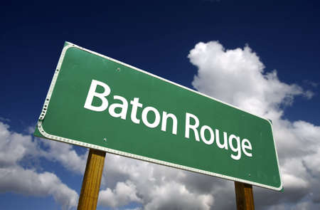 rouge: Baton Rouge Road Sign with dramatic blue sky and clouds - U.S. State Capitals Series. Stock Photo
