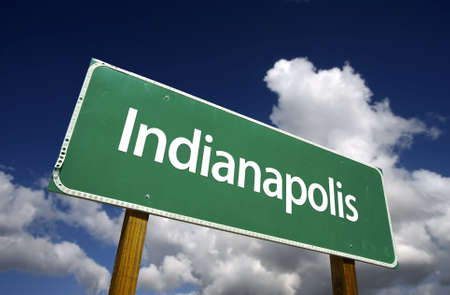 indianapolis: Indianapolis Road Sign with dramatic blue sky and clouds - U.S. State Capitals Series.