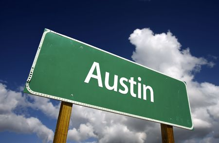austin: Austin Road Sign with dramatic blue sky and clouds - U.S. State Capitals Series.